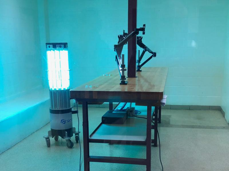A robot emits high-intensity ultraviolet light in a booking room at the Kent County Jail in Grand Rapids, Michigan. LARRY PEREZ/SKYTRON
