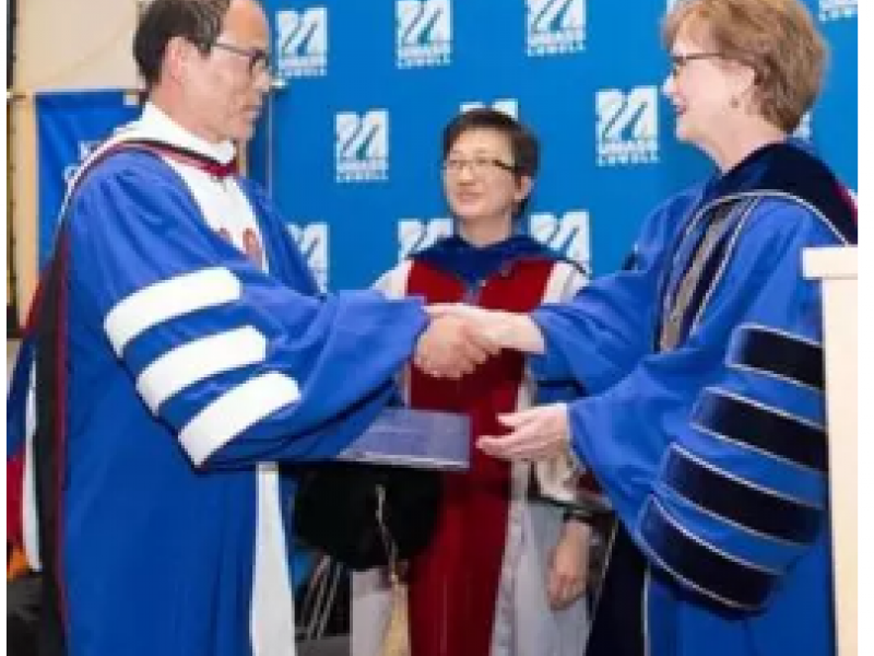 Shuji Nakamura (left) is presented a doctorate of humane letters by UMass Lowell Chancellor Jacquie Moloney (right) and Vice Chancellor of Research and Innovation Julie Chen.