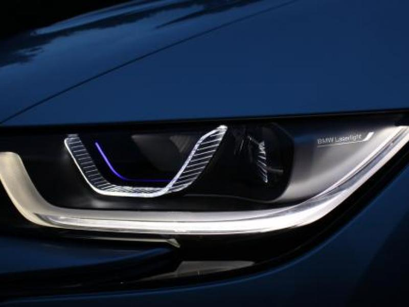 The i8, which has the optional laser headlights, will be on sale in Europe this summer. BMW is working with the U.S. Department of Transportation to get it approved for a U.S. release. Credit BMW